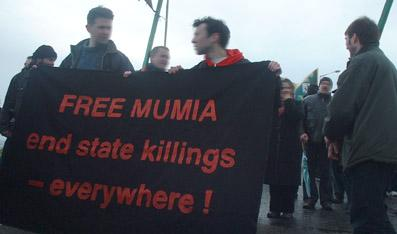 Free Mumia banner at Bloody Sunday march in Derry, Ireland