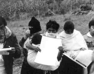 Women Zapatistas reading newspaper